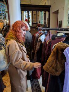 Browsing a rail of Biba garments